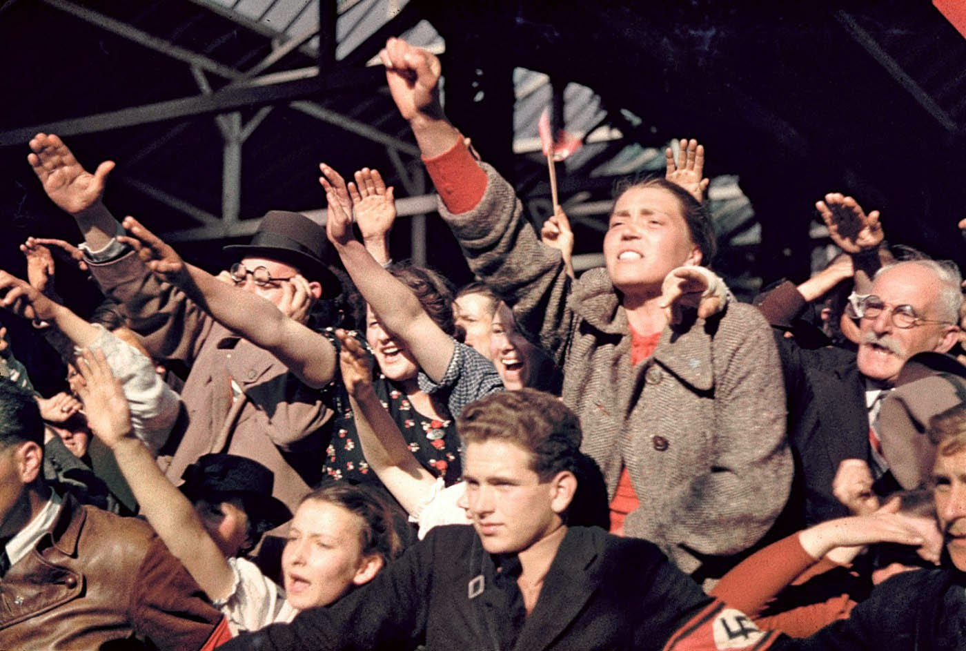Crowds cheering Adolf Hitler's campaign to unite Austria and Germany, 1938..jpg