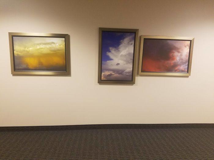 Вот так картины повесили в холле офиса.