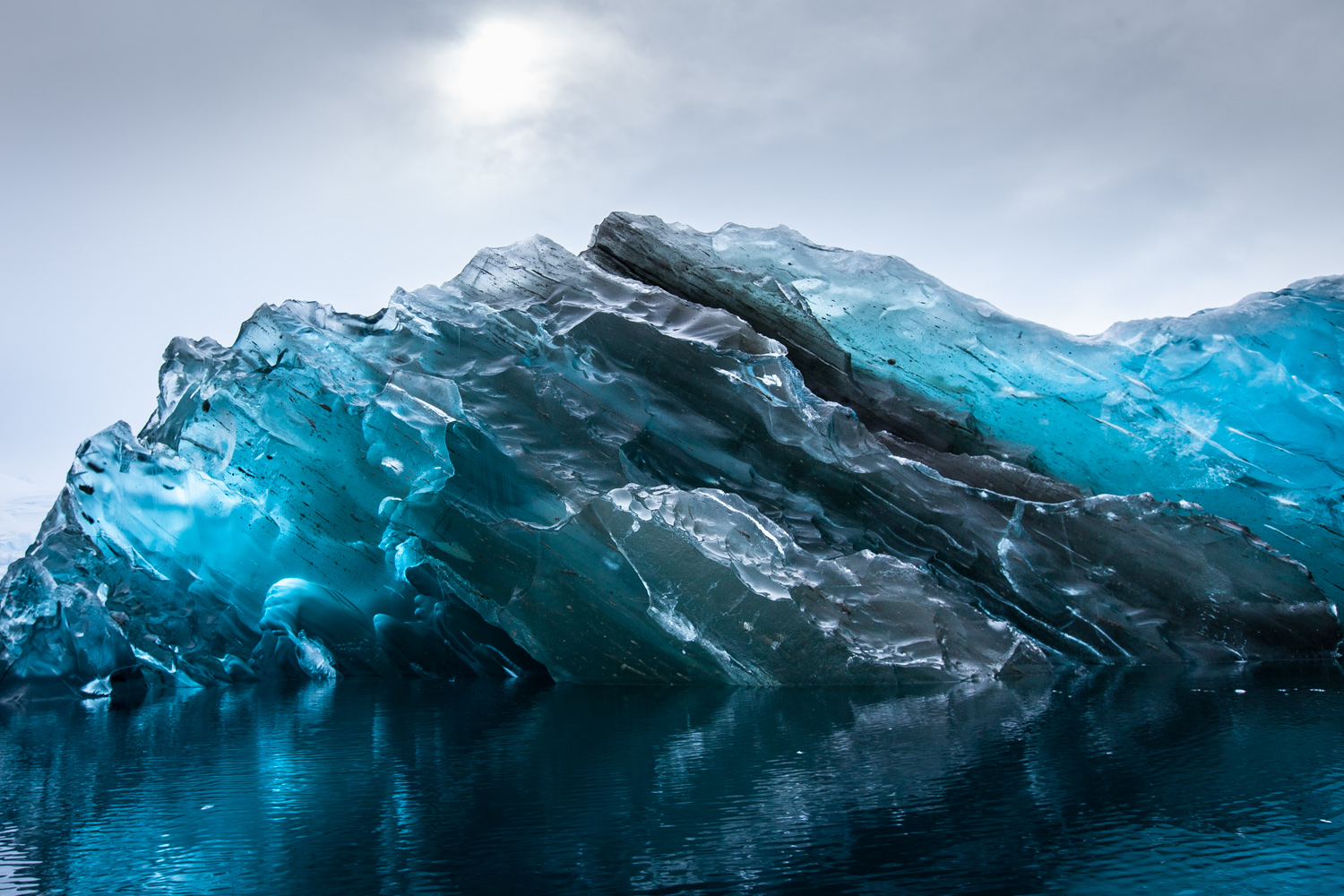 A Rare Flipped Iceberg in Antarctica Photographed by Alex Cornell