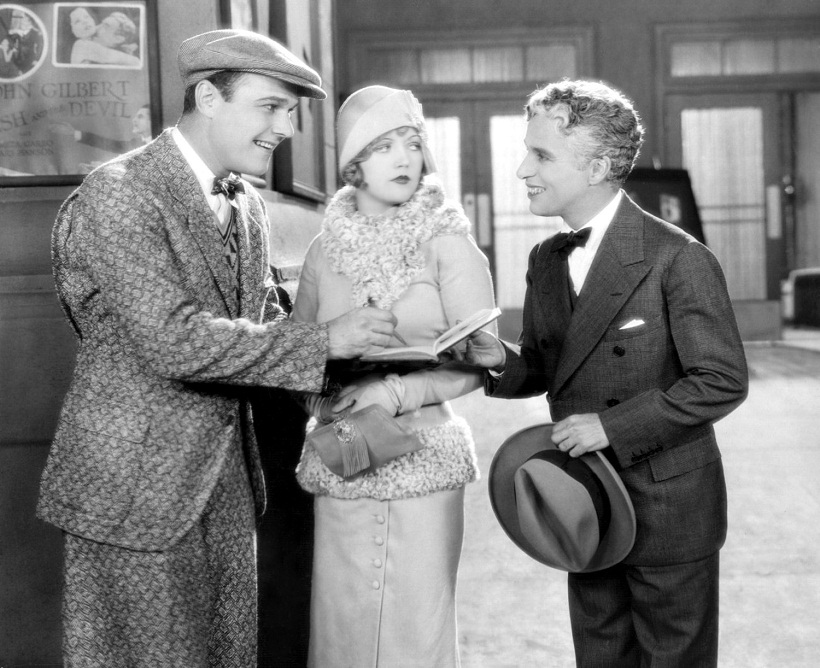 1928: American leading man William Haines (1900 - 1973) stars with Marion Davies (1897 - 1961) and legendary British comedian Charles Chaplin (1889 - 1977) in the film 'Show People', directed by King Vidor for MGM. Chaplin appeared without make-up as himself for the extra's