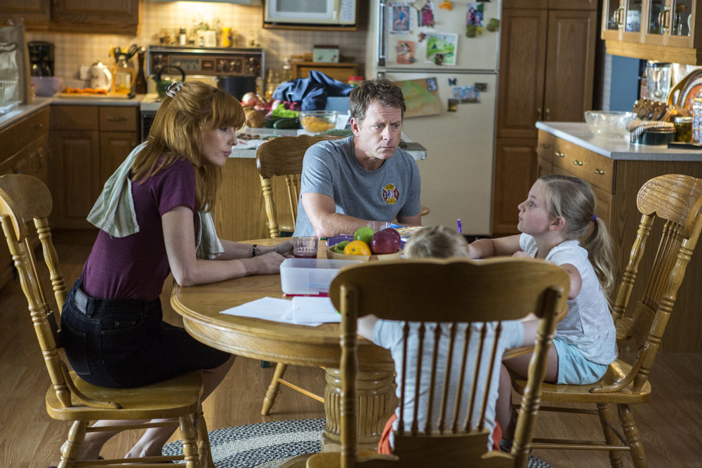 Cassie (Lane Styles, RIGHT) confesses that she punched two boys to her mom (Kelly Reilly, LEFT) and dad Todd (Greg Kinnear, CENTER) while her brother Colton (Connor Corum) looks on in TriStar Pictures' HEAVEN IS FOR REAL.