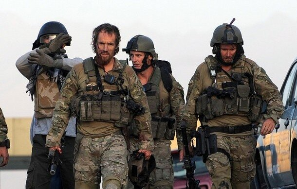 Non-Afghan soldiers leave after taking p
