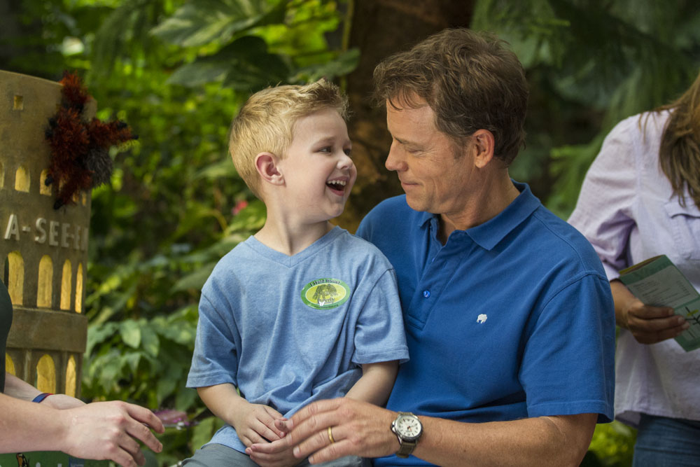 Colton (Connor Corum) holds a tarantula at the Denver Butterfly Pavilion with his father (Greg Kinnear) in TriStar Pictures' HEAVEN IS FOR REAL.