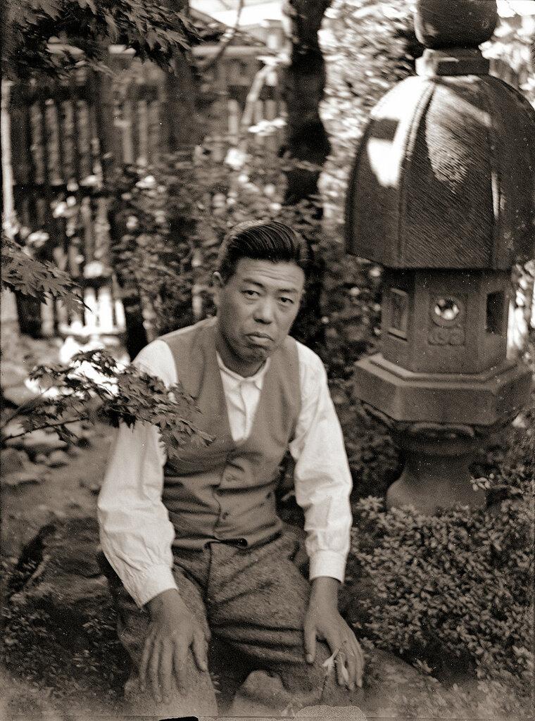 Man In Vest & Stone Lantern, 1930s Japan.