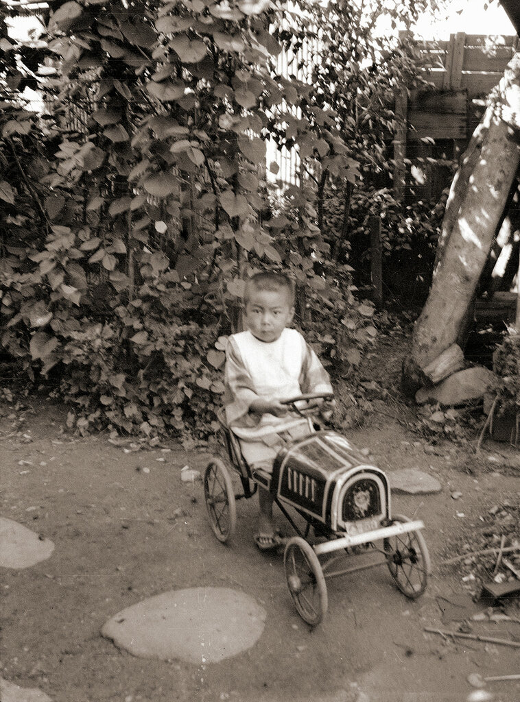 Young Boy on Toy Car, 1930s Japan.
