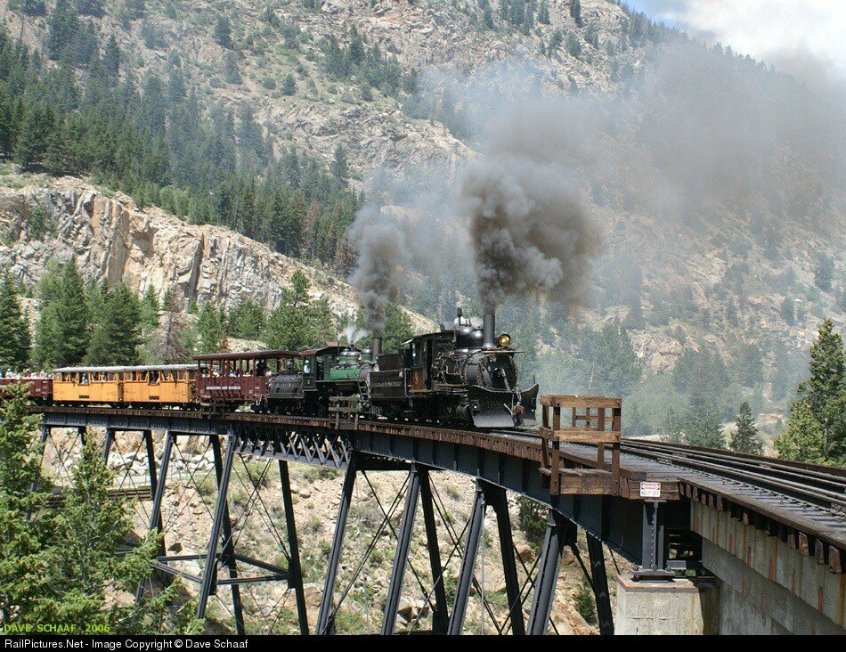 Colorado & Southern Steam #9 & #12, to climb across the Devil's Gate trestle at the Georgetown Loop, Georgetown, Colorado, USA. August 01, 2006.