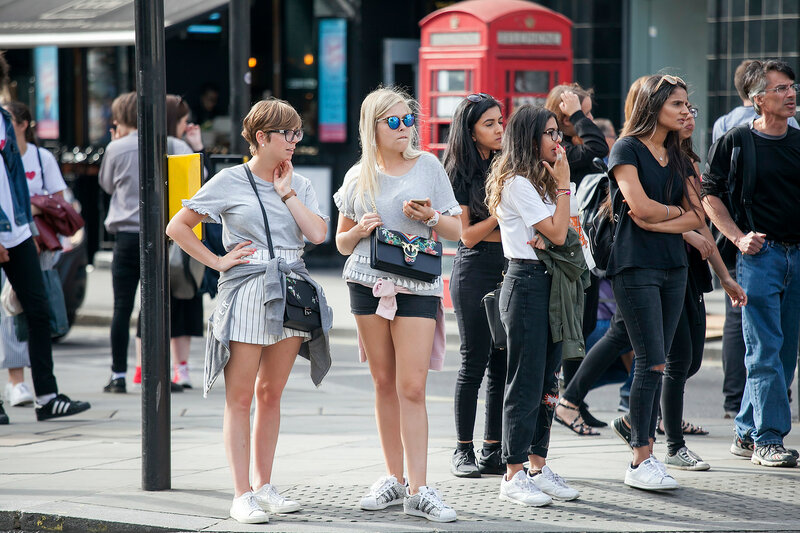 LONDON, ENGLAND - August 11 2017 A multicolored crowd walks along Carnaby Street. Carnaby Street is one of the main shopping streets of London.