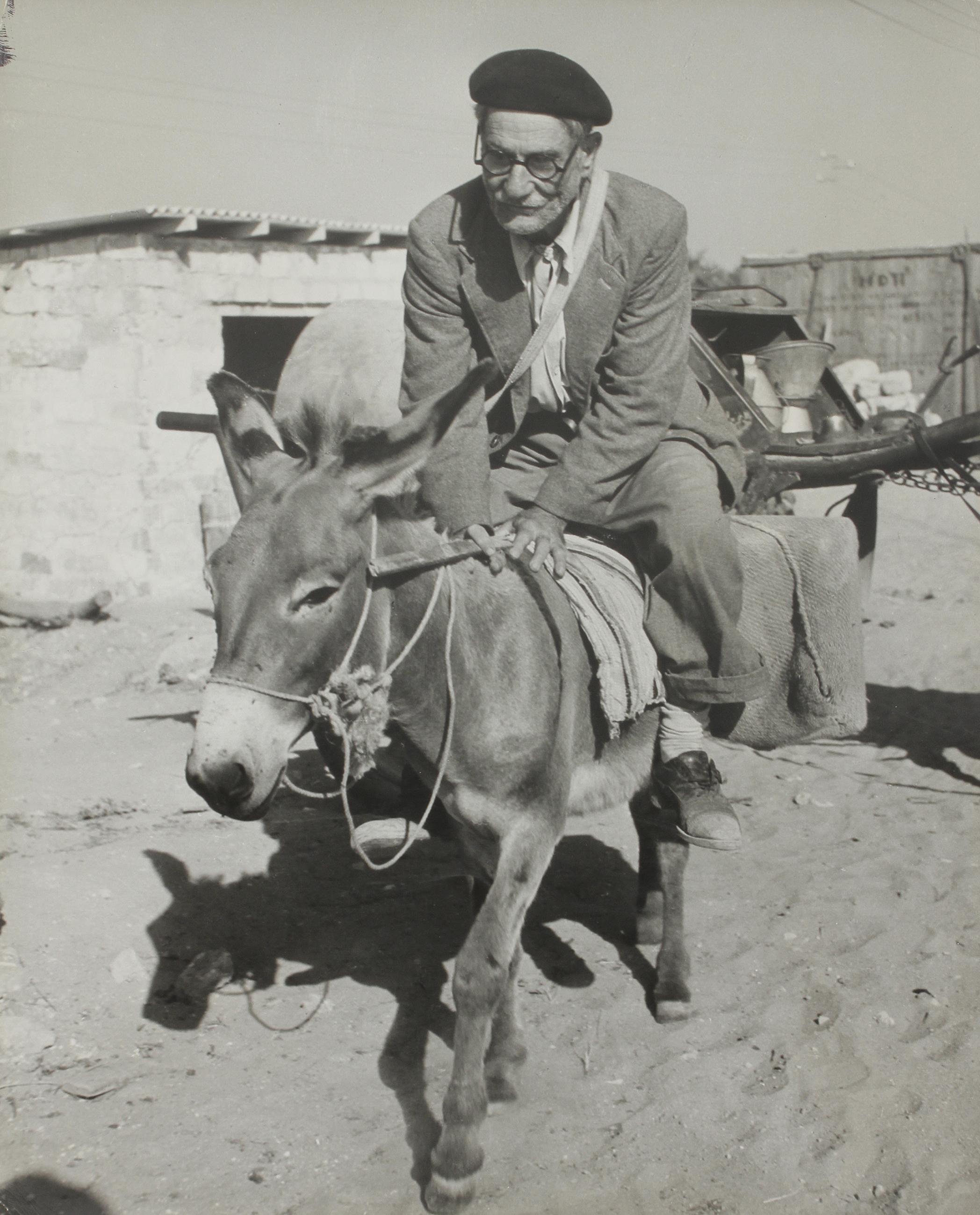 1948. Торговец на осле