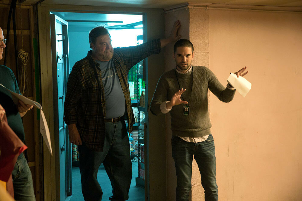 (L-R) John Goodman and director Dan Trachtenberg on the set of 10 CLOVERFIELD LANE, by Paramount Pictures