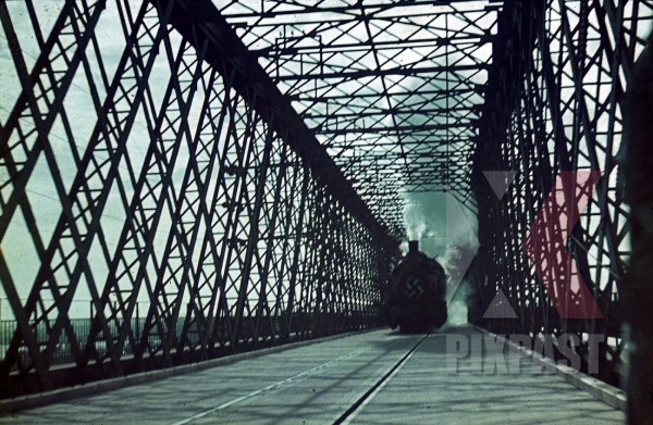 stock-photo-ww2-color-german-troop-transport-train-with-swastika-red-flag-bridge-smoke-ukraine-river-1942-7943.jpg