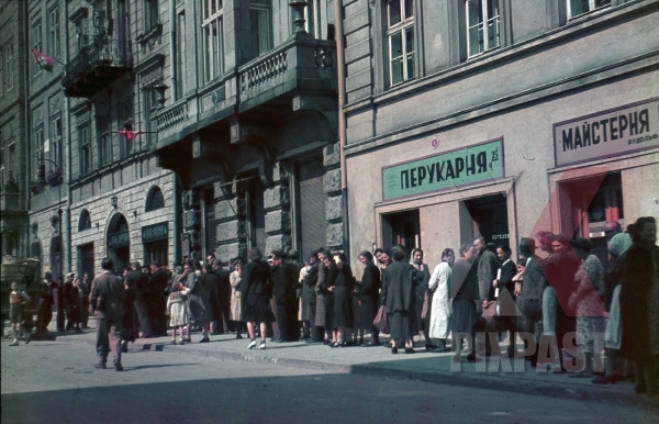 stock-photo-ww2-color-poor-peasents-waiting-for-documents-from-german-government-office-in-town-ukraine-hand-made-red-flags-1942-7950.jpg