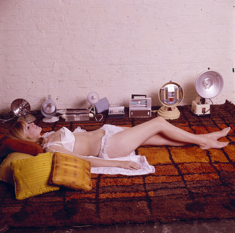 1965 Sunbathing by lamplight seems odd, but at least she looks cute in her ruffled white lingerie.jpg