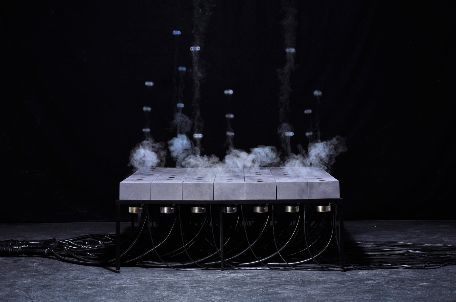 A Grid of Audio Speakers That Shoots Fleeting Patterns of Fog by Daniel Schulze