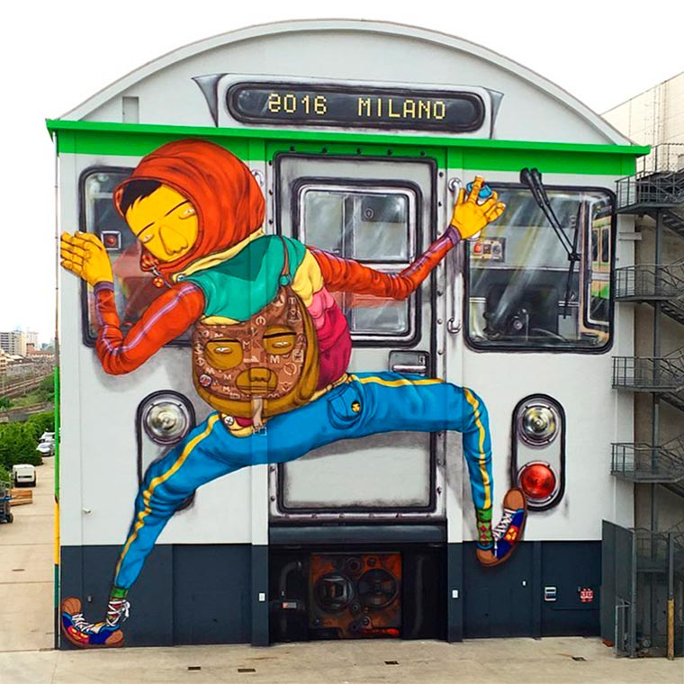 Street Art - Os Gemeos transform a warehouse into a gigantic subway train!
