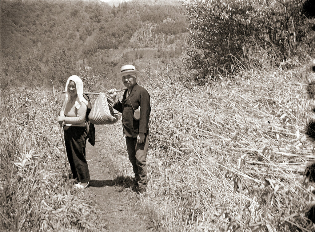 Man and Woman Carrying Bundle, 1930s Japan.