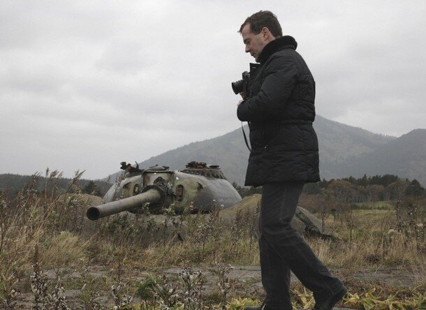 Russia's President Dmitry Medvedev takes pictures during his visit to Kunashiri Island, one of four islands known as the Southern Kuriles in Russia and Northern Territories in Japan