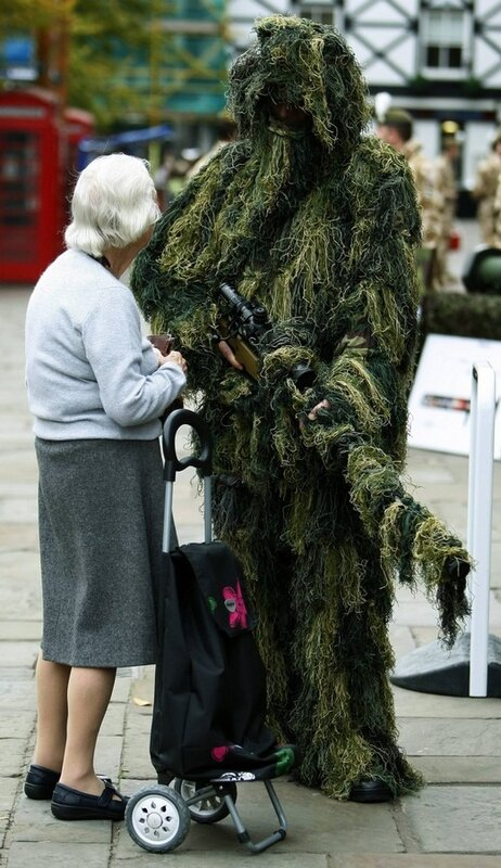 A woman talks with a sniper from 1st Battalion The Royal Welsh in Chester, northern England