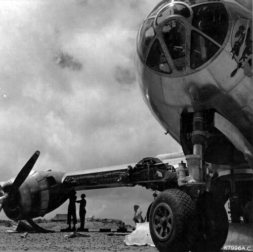 """7th Air Force personnel examine a Boeing B-29 """"Superfortress"""" which crashed on Iwo Jima, Bonin Islands.    July 1945."""
