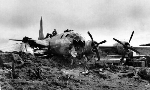 Nose view of Boeing B-29 42-24664 500th Bomb Group Ramblin Roscoe, that crashed on night landning on Iwo Jima.  Before coming to rest on embankment, the plane ran into a truck, killed a Seabee, and injured two men sleeping in a tent.