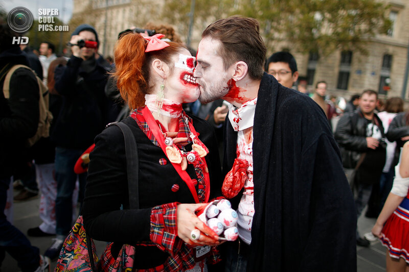 A couple dressed as zombies participates in a Zombie Walk procession in the streets of Paris