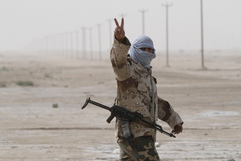 A Libyan rebel soldier flash the V sign