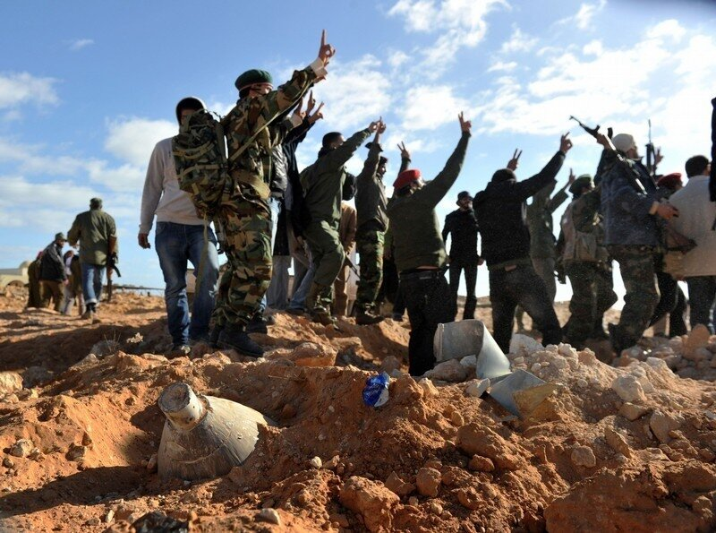 Libyan rebel fighters celebrate near an