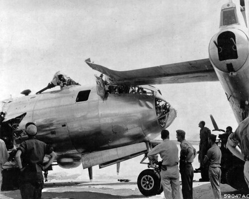 Boeing B-29 Superfortress crashed into another battle-damaged B-29 at Iwo Jima, Bonin Island Group.  Bombardier's sprained ankle was the only injury.