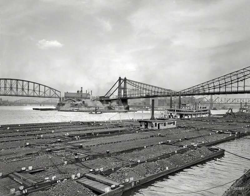 Circa 1910. Coal barges at confluence of Allegheny and Monongahela rivers at Pittsburgh, Pennsylvania