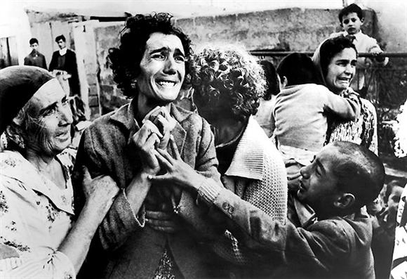 Don McCullin - A Turkish woman mourns her dead husband, victim of the Greek-Turkish civil war.