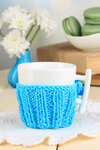 Cup with knitted thing on it close up
