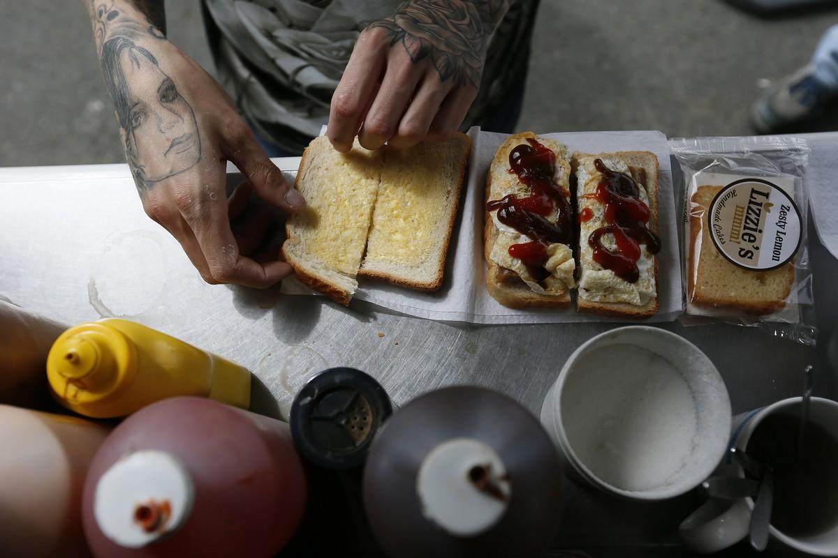 A man prepares a sandwich outside a snack van along the A22 near Caterham