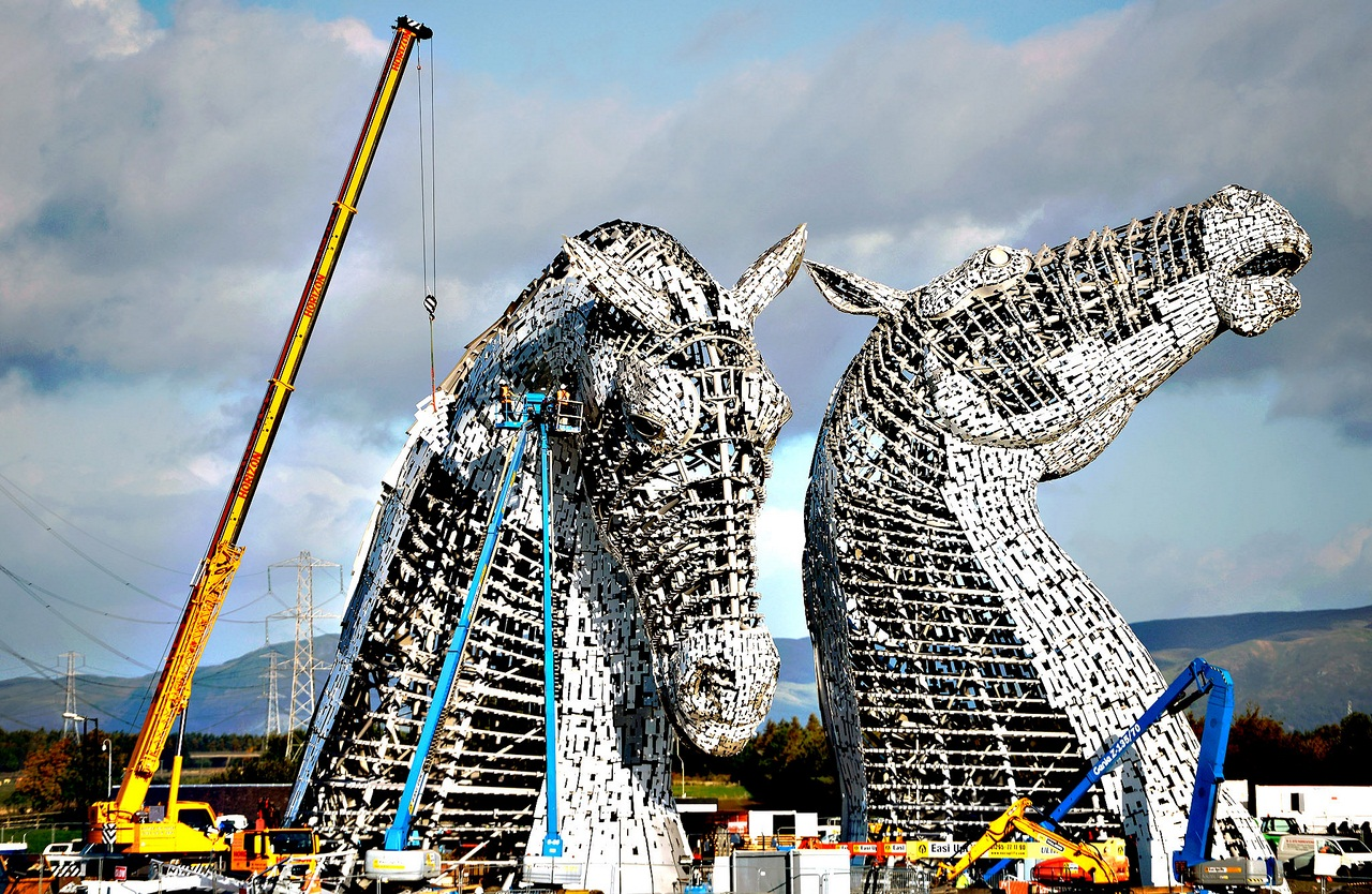 30 Meter Horse Head Sculptures Near Completion...FALKIRK, SCOTLAND - OCTOBER 09:  Work continues on The Kelpies sculptures at the eastern entrance to the Forth and Clyde canal on October 10, 2013 in Falkirk, Scotland. The two Kelpie heads are positioned a