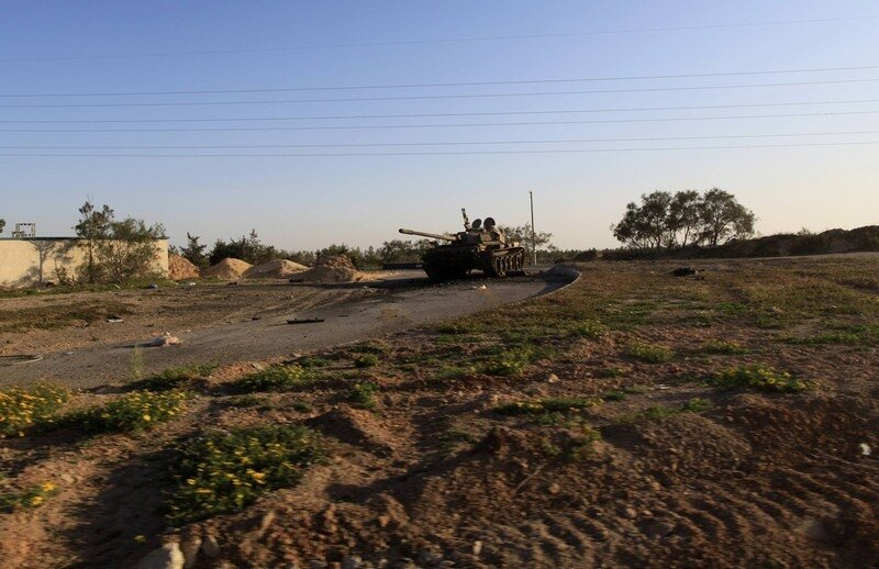 A Libyan tank belonging to soldiers loyal to leader Muammar Gaddafi take position in the city of Misrata
