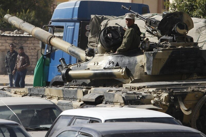 A Libyan army tank guards a traffic intersection in Tripoli