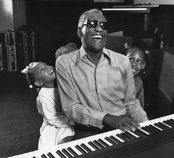 Ray Charles with his grand-daughters