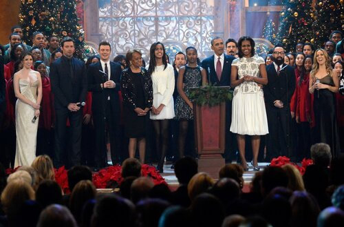 WASHINGTON, DC - DECEMBER 15: (L-R) Anna Kendrick, Hugh Jackman, Nick Carter, Marian Shields Robinson, Malia Obama, Sasha Obama, US President Barack Obama, First Lady Michelle Obama, A.J. McLean, and Sheryl Crow onstage at TNT Christmas in Washington 2013