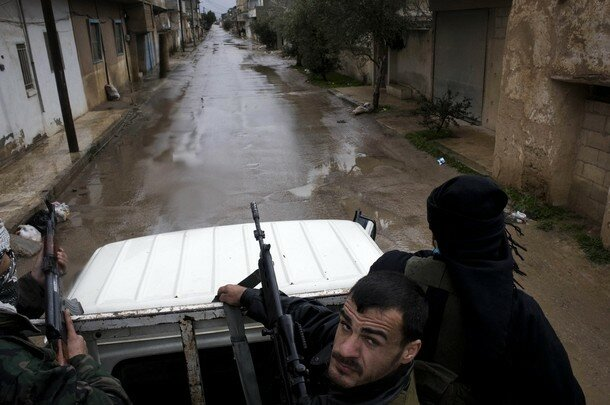 Members of the Free Syrian Army patrol a
