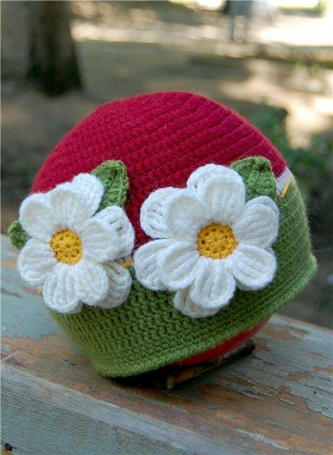 связать крючком зимнею шапку для девочки.