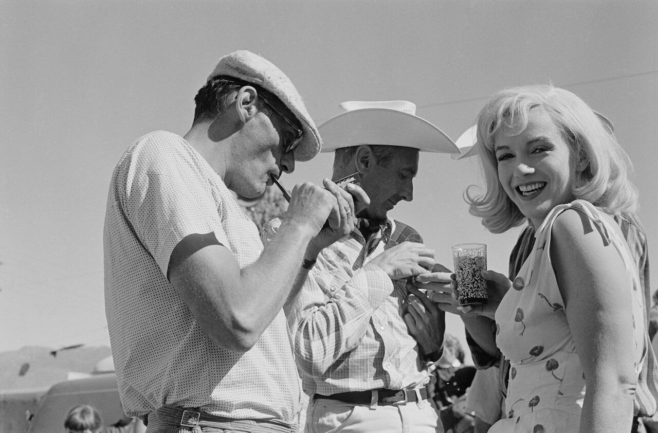 1960: American film star Marilyn Monroe (1926 - 1962), born Norma Jean Mortenson, in Nevada with her husband Arthur Miller (left) and producer Frank E Taylor for the location filming of 'The Misfits', written by Miller. (Photo by Ernst Haas/Ernst Haas/Get