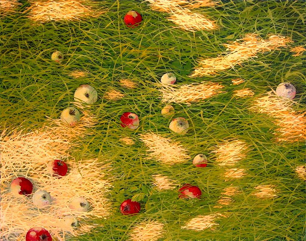 Яблоки в траве.