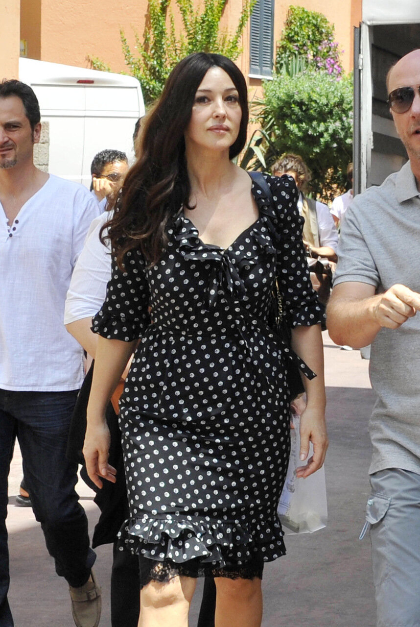 Italian actress Monica Bellucci seen wearing a black and white polka dot dress while out and about with Paul Higgis in Ischia, Italy