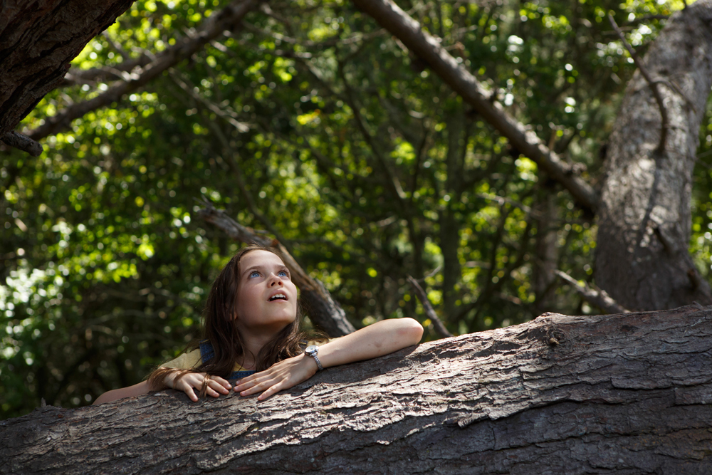 Oona Laurence is Natalie in Disney's PETE'S DRAGON, the adventure of a boy named Pete and his best friend Elliot, who just happens to be a dragon.