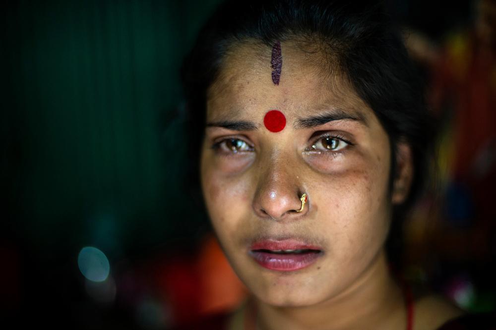 Дипе 26 лет. На фотографии женщина плачет. Сейчас она на втором месяце беременности. Отец ребенка —