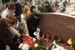Romanians attend a commemoration at the grave of Romania's late communist dictator Nicolae Ceausescu in a Bucharest cemetery