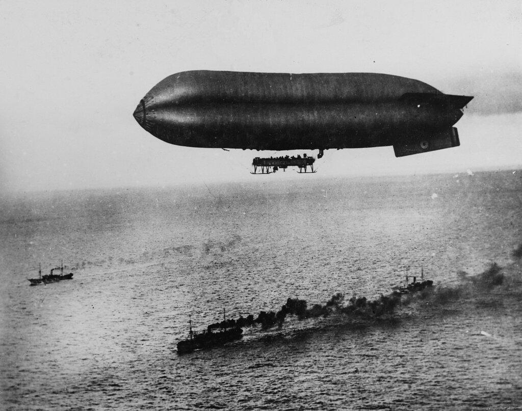 An airship escorts a convoy into Brest Harbor, 1918