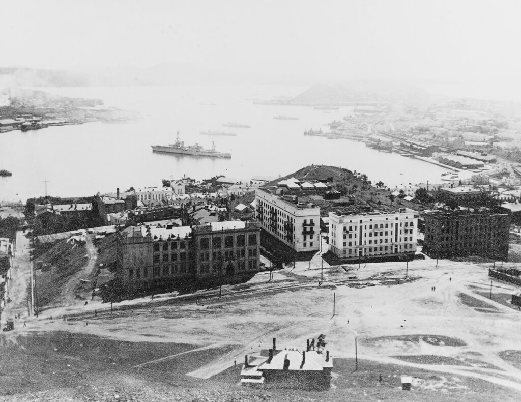 USS AUGUSTA (CA-31). View of visiting U.S. naval squadron at Vladivostok, Russia, 26 July-1 August 1937, in the harbor. The stern of one U.S. destroyer can be seen to the left of the picture while the other three are in line broadside to each other and the USS AUGUSTA (CA-31), to the left of center. The four destroyers are: USS PAUL JONES (DD-230), USS WHIPPLE (DD-217), USS ALDEN (DD-211), and USS BARKER (DD-213).