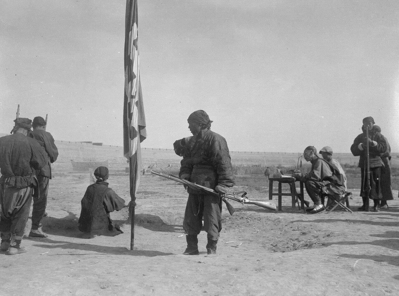 Китайские солдаты на стрельбище