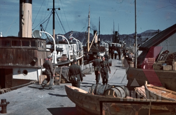 stock-photo-ww2-color-norway-1940-shipping-cargo-harbour-soldiers-petrol-supplied-norwegian-flag-7997.jpg