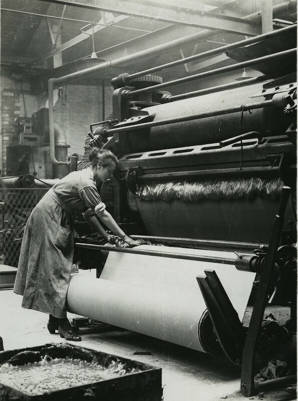 British rubber workers in Lancashire spreading machine for coaling canvas for tire making