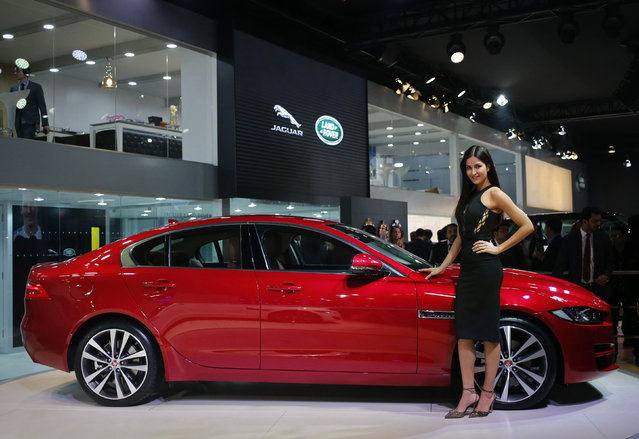 Bollywood actress Katrina Kaif poses with the Jaguar XE during its launch at the Indian Auto Expo in